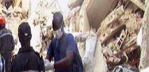 Marché Ocass : Le pan d'un bâtiment s'effondre sur une dame