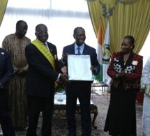 Moustapha Niasse élevé à la dignité de Grand-croix du mérite ivoirien en présence de Ouattara